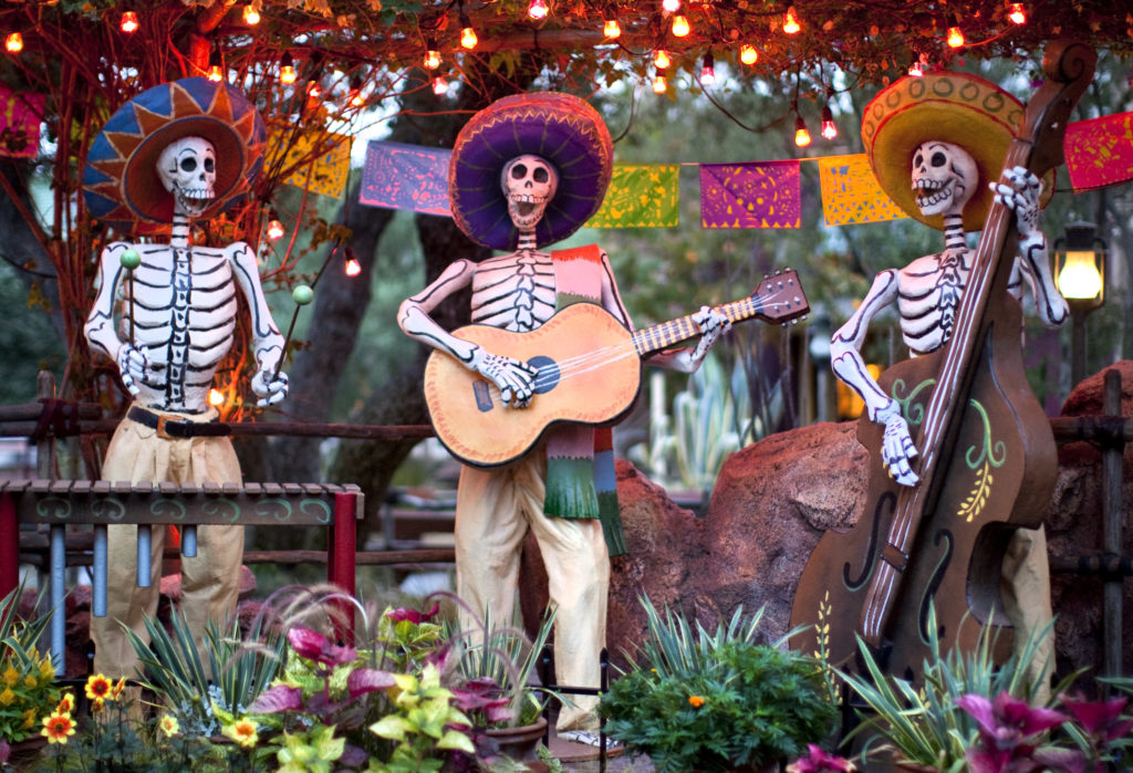 "DIA DE LOS MUERTOS (ANAHEIM, Calif.) – A colorful display at Disneyland park honors Dia de los Muertos with cheerful skeletons, sugar skulls and marigolds during Halloween Time at the Disneyland Resort, from Sept. 9 through Oct. 31 2016. The Halloween season features seasonal entertainment and décor, in addition to the return of Haunted Mansion Holiday and Space Mountain Ghost Galaxy. This year, the family-friendly Mickey's Halloween Party will be held on 17 nights at Disneyland Park, where guests are invited to trick-or-treat in costume, celebrate with favorite Disney characters and enjoy the ""Halloween Screams"" fireworks spectacular. (Paul Hiffmeyer/Disneyland Resort)"